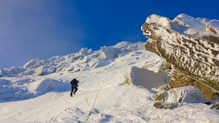 Abseiling down for winter climbing on Cnap Coire na Spreidhe Cairngorms