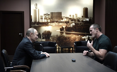 Vladimir Putin at a meeting with boxer Denis Lebedev.