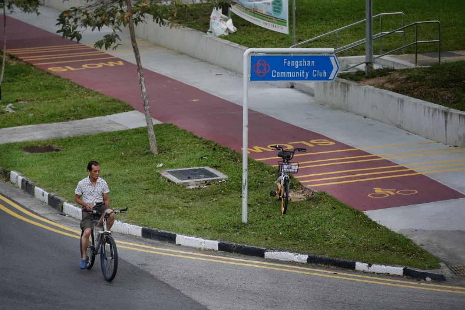 An errant cyclist cycles on the road instead of the red path along Bedok North Avenue 3 and near Bedok North Street 2 on 21 December 2017.