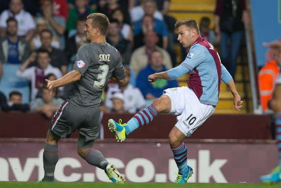 Andreas Weimann shoots to score Aston Villa's first goal against Rotherham