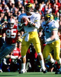 Ohio State had super star WR Chris Carter. Their defense was led by  outstanding LB Chris Spielman. f01076438