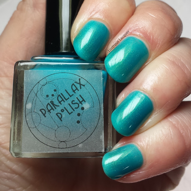 Sea-Foam-Secrets-7-seas-collection-Parallax-Polish-shimmer-teal-nail-polish-with-a-golden-glow