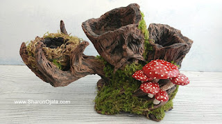 handmade tree man holding mushrooms