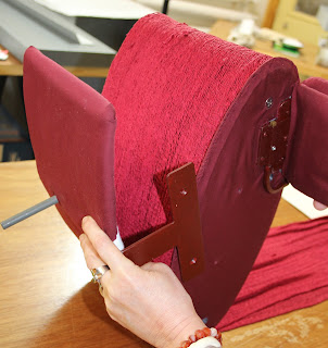 Custom mount for display and exhibit of an 18th century red silk officer's sash, conservation, mount making for historic garments, textile conservator Gwen Spicer of Spicer Art Conservation, Military artifacts, collectibles, antiques, display, restoration, repair, preservation