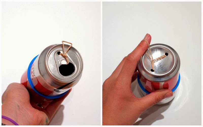 pierce two holes in both ends of the soda can