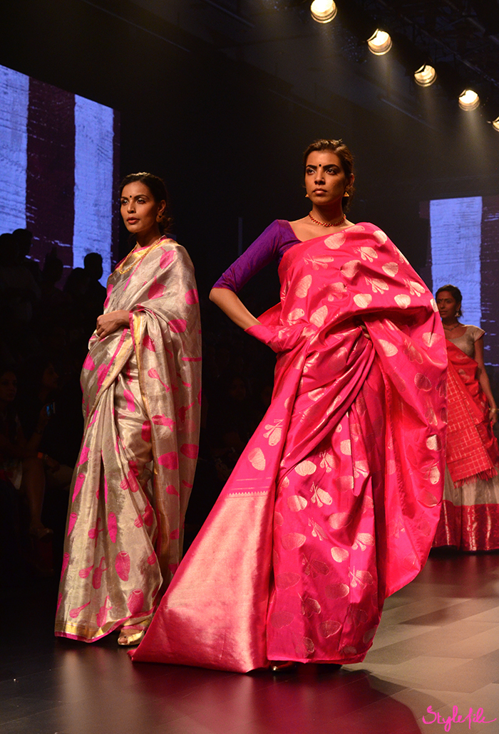 A model wears a traditional Indian saree in bright colours at Lakme Fashion Week in Mumbai India