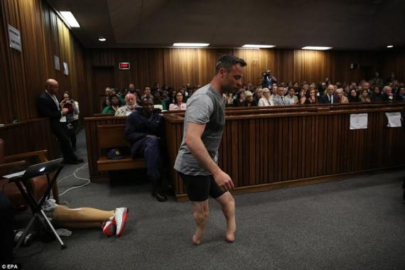 picture of Oscar Pistorius walking round in the court room at his trial without his prosthetic legs