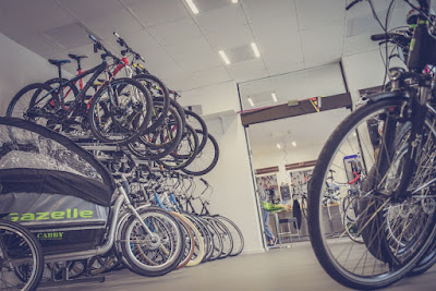 pexels.com/photo/bicycle-hanged-and-piled-on-bicycle-shop