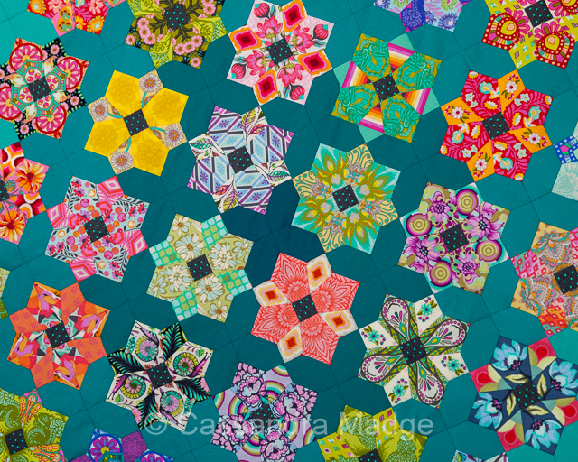 Close up of teal and bright coloured Epic Tule Quatro Quilt by Cassandra Madge