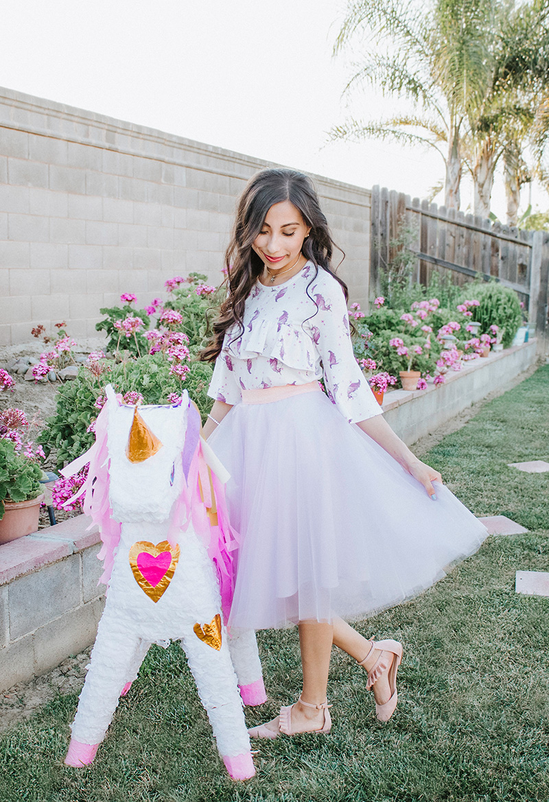 unicorn ruffle blouse with pastel tulle skirt looking down
