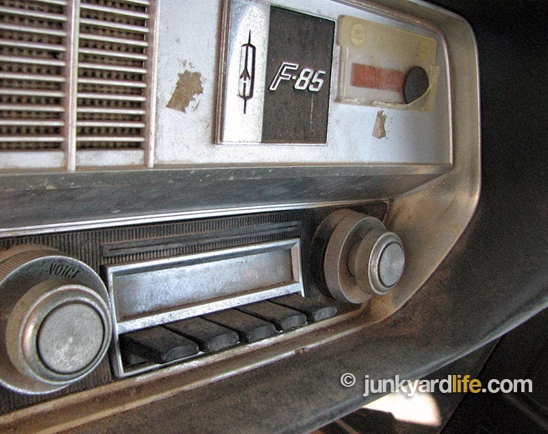 Original AM push-button radio sits in the dash of the 1967 F-85 Olds.