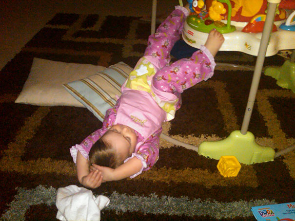 15+ Hilarious Pics That Prove Kids Can Sleep Anywhere - Napping Next To A Baby's Chair