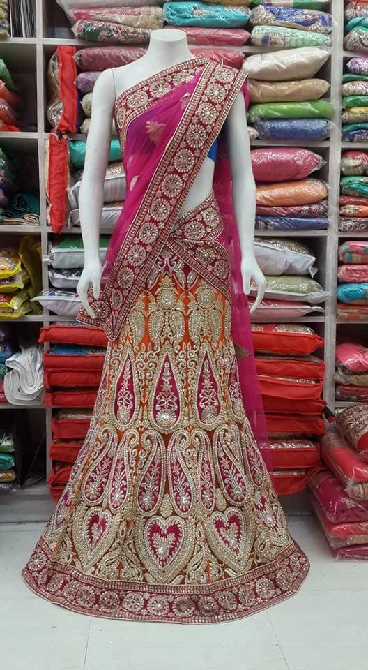 pure hand tuch stone work heavy bridal orenge pink wedding lehenga by sharmili saree