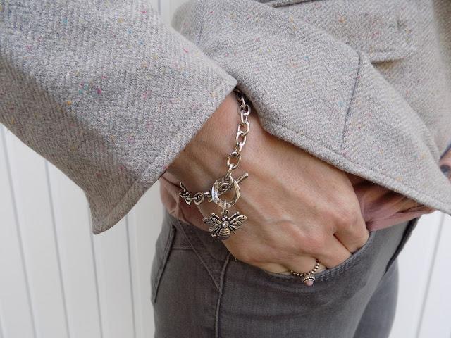 Grey jersey herringbone blazer with grey skinny jeans and pink brogues