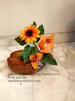 flowerarrangement in coconut shell