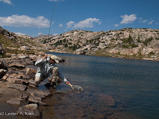 Angler netting a cutthroat trout in Fossil Lake, Montana