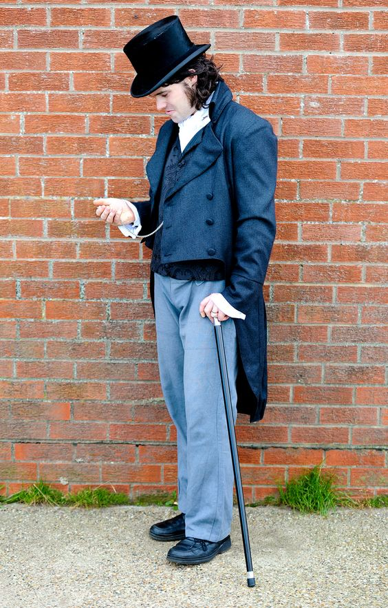 Steampunk Man wearing navy blue, gray, and black clothing (tailcoat, waistcoat, ascot, top hat, trousers, pocket watch and cane)