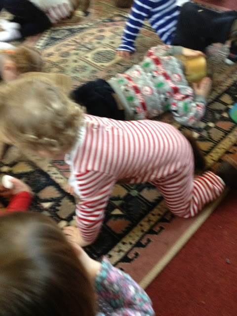 toddler on hands and knees about to lie down