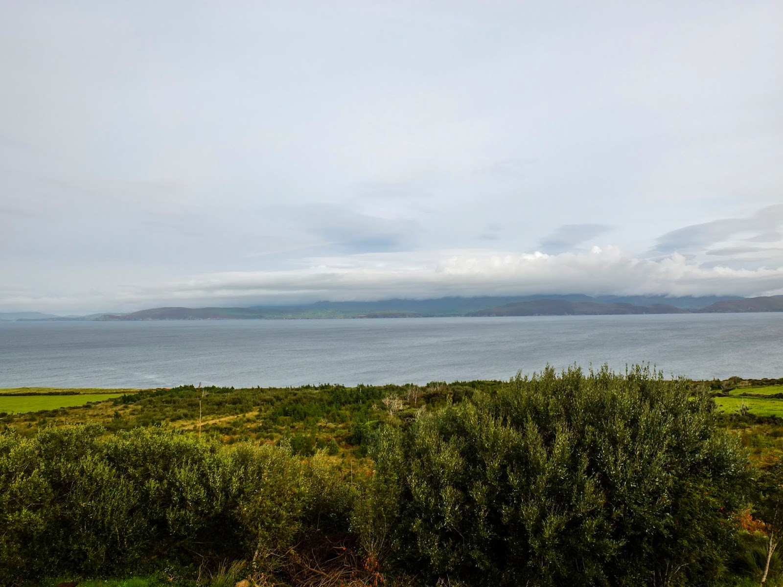 Views of the Iveragh Peninsula from the roadside on a gloomy day.