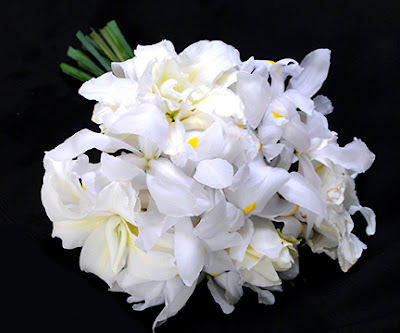 white iris and rose lily wedding bouquet