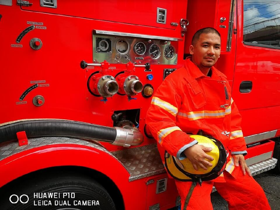 Earl Sunga - a volunteer firefighter from Tondo Manila; Photographed by Dookie Ducay