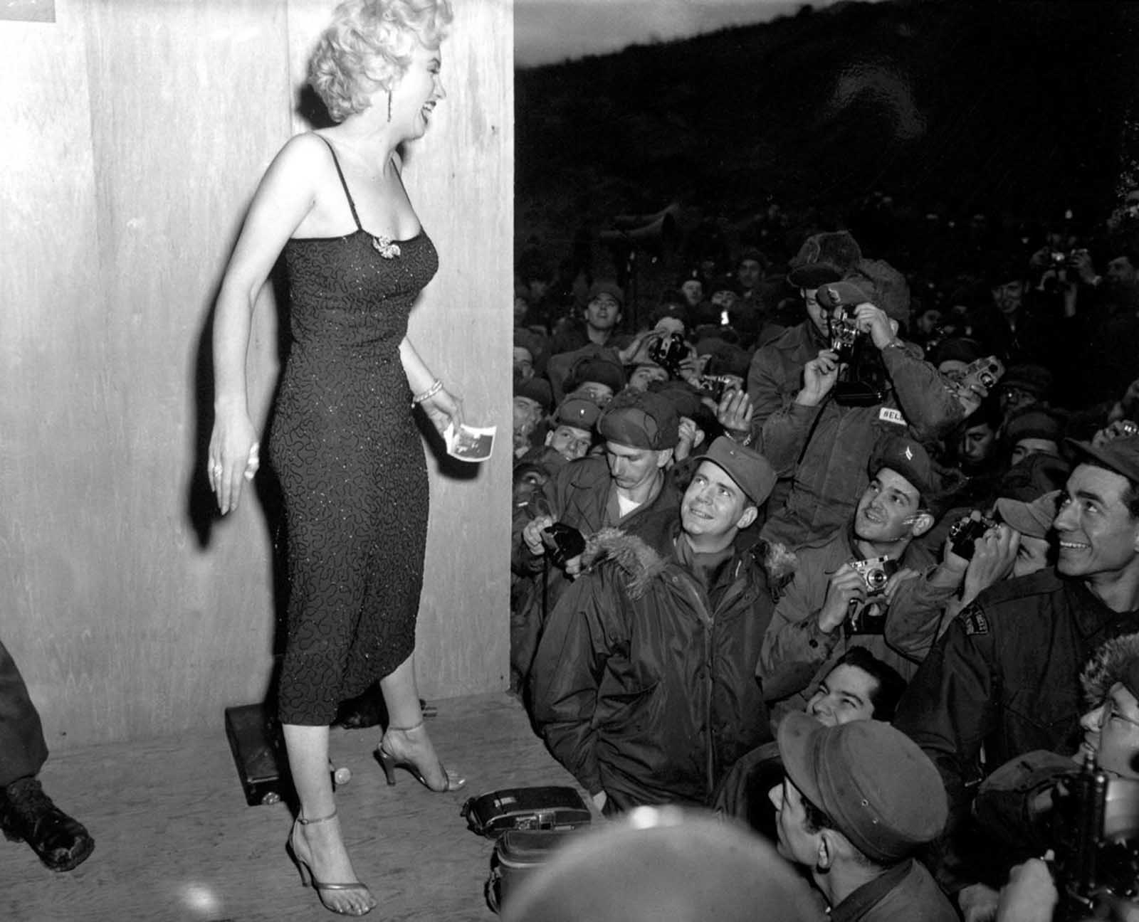 Monroe posing for soldiers in Korea.