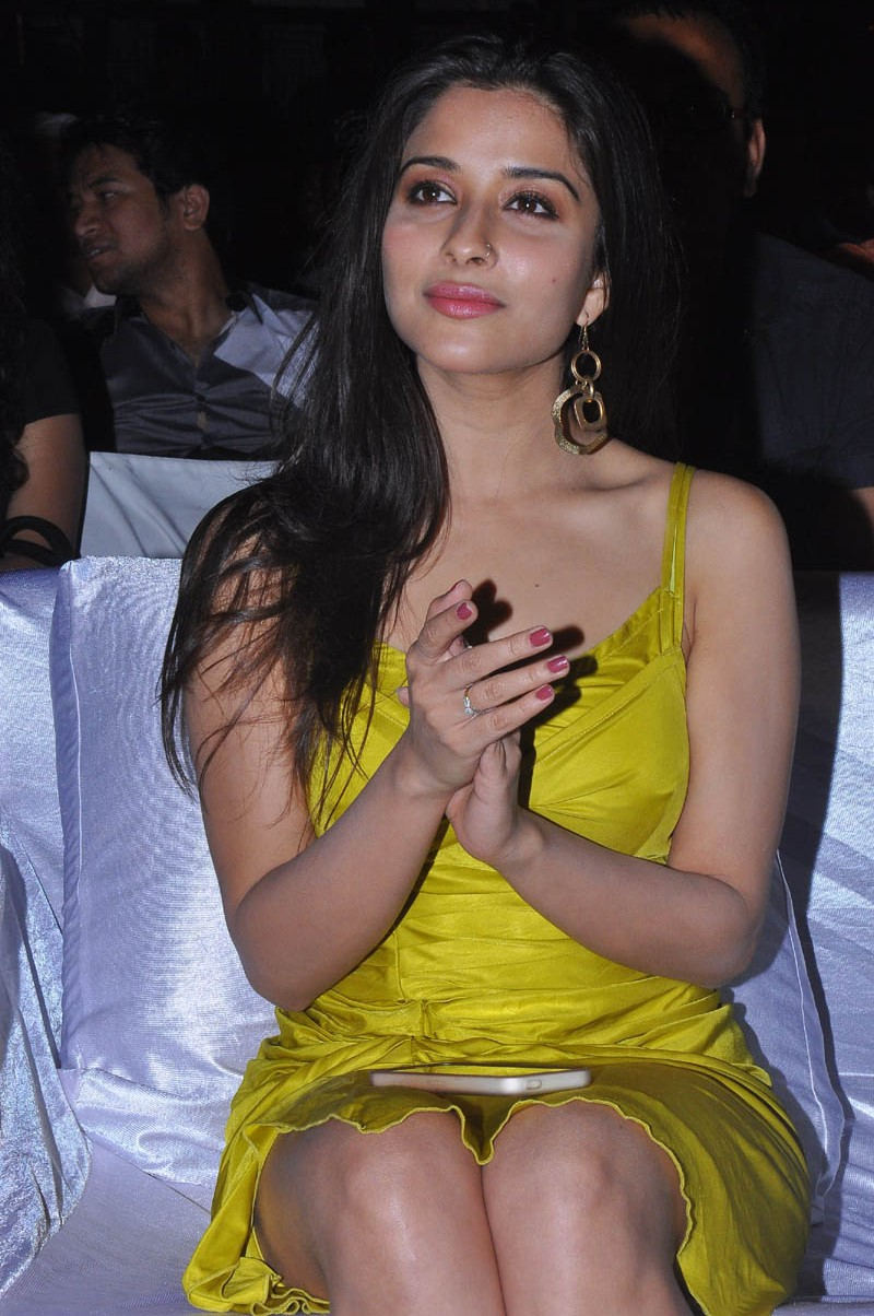 South Indian Glamorous Actress Madhurima Hot Thigh Show Photos In Yellow Dress