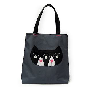 swaggy bucket bag with cat logo.