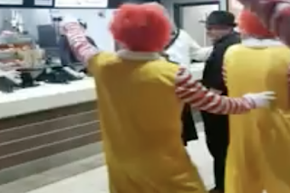 Mob of Ronald McDonalds invades 's–t' Burger King
