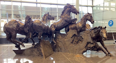 Calgary airport wild horses bronze statue
