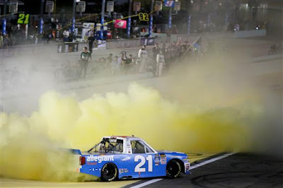 Johnny Sauter, driver of the #21 Allegiant Travel Chevrolet, celebrates with a burnout after winning the #NASCAR Camping World Truck Series Championship at Homestead-Miami Speedway.