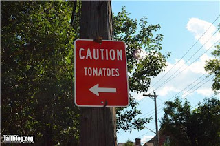 confusing signpost - caution tomatoes
