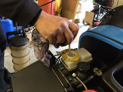 Old brake fluid removed from reservoir