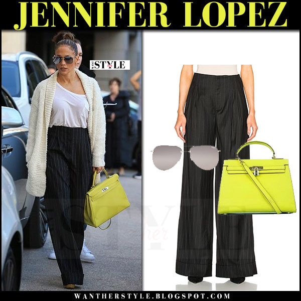 Jennifer Lopez in black pinstripe etro trousers with yellow Hermes Kelly bag what she wore