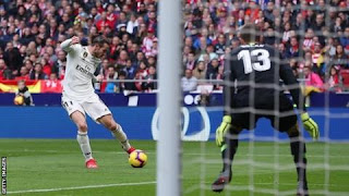 Gareth Bale scored his 100th Real Madrid goal as they beat Atletico in the Madrid derby to overtake their rivals into second place.
