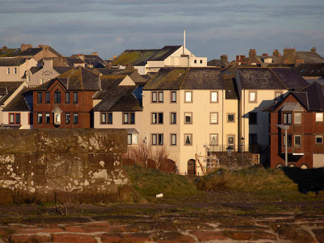 Photo of the housing development around Maryport Harbour from the path along the sea wall