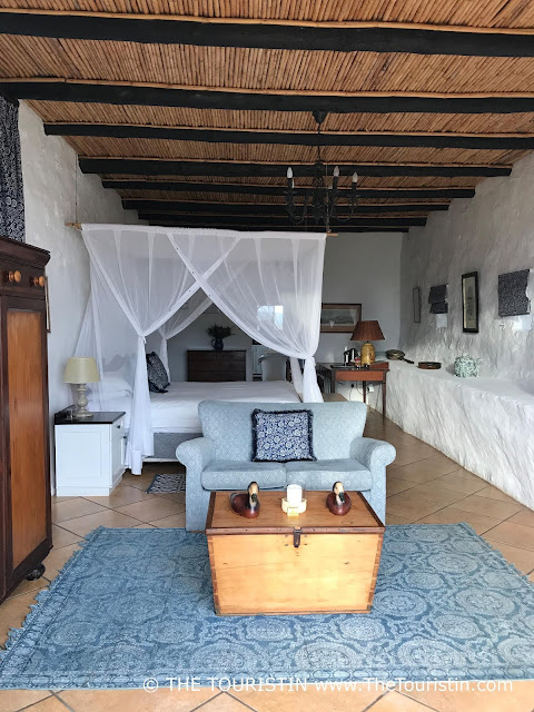 The white and blue country and cottage style interior design of the Vlei Suite at the De Hoop Nature Reserve