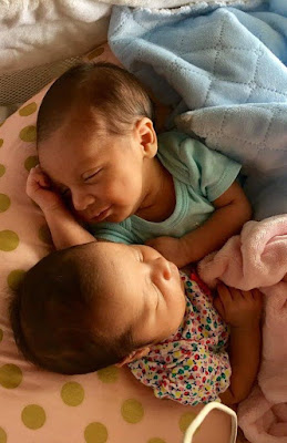 Adorable Photos Of Infant Twins Embracing While Sleeping Go Viral