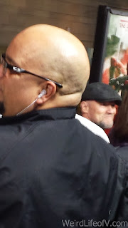 Michael Rooker in the background and Louis Love in the foreground