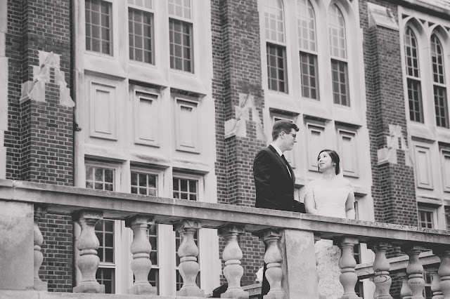bride and groom on balcony at Grosse Point Academy