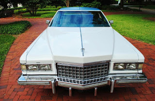 White 1976 Cadillac Fleetwood Brougham Front