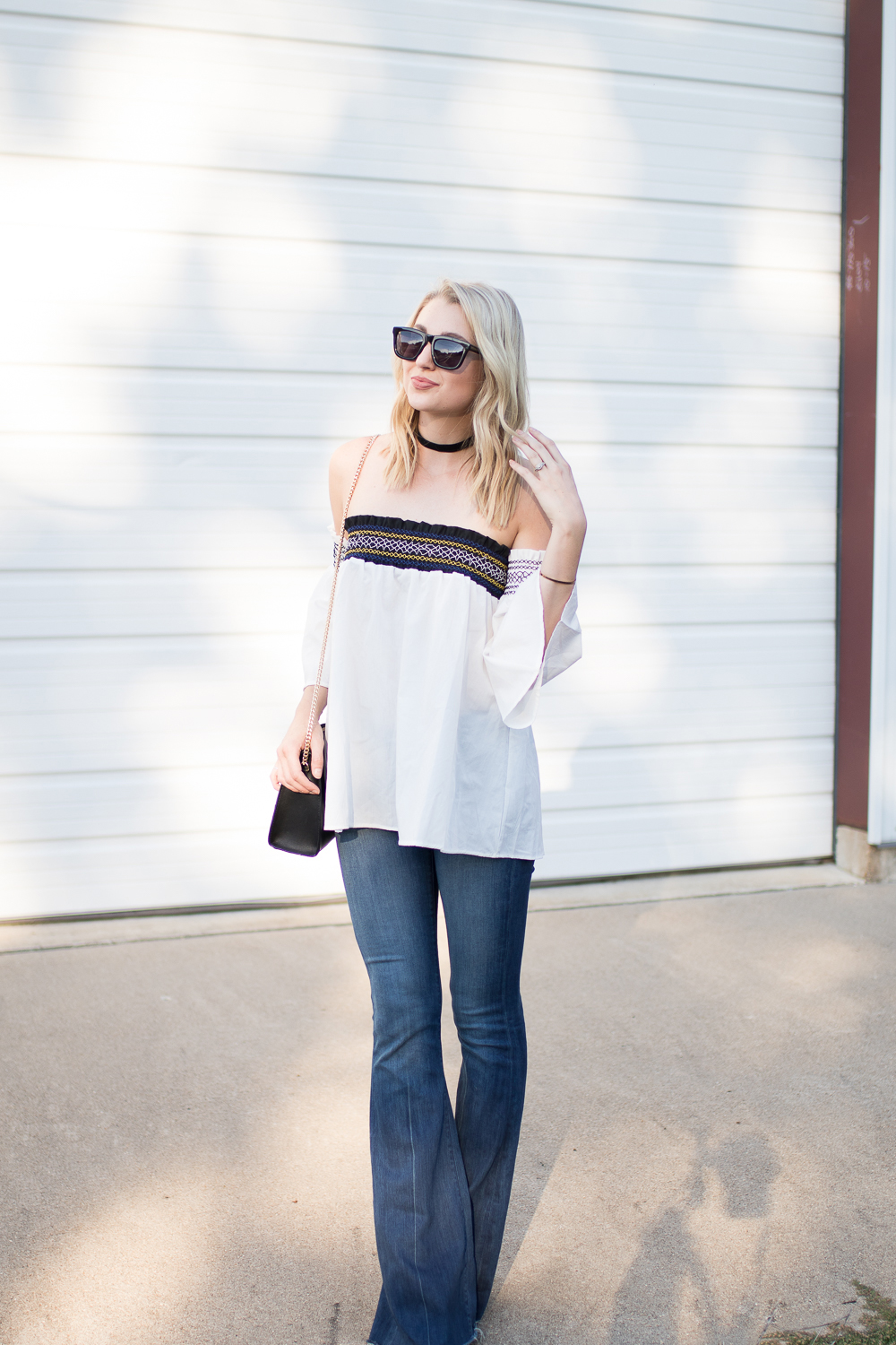 white off-shoulder top with long flares