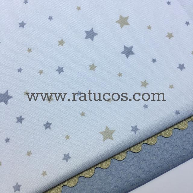 http://ratucos.com/es/telas/7522-pique-canutillo-multi-estrellas-azul.html