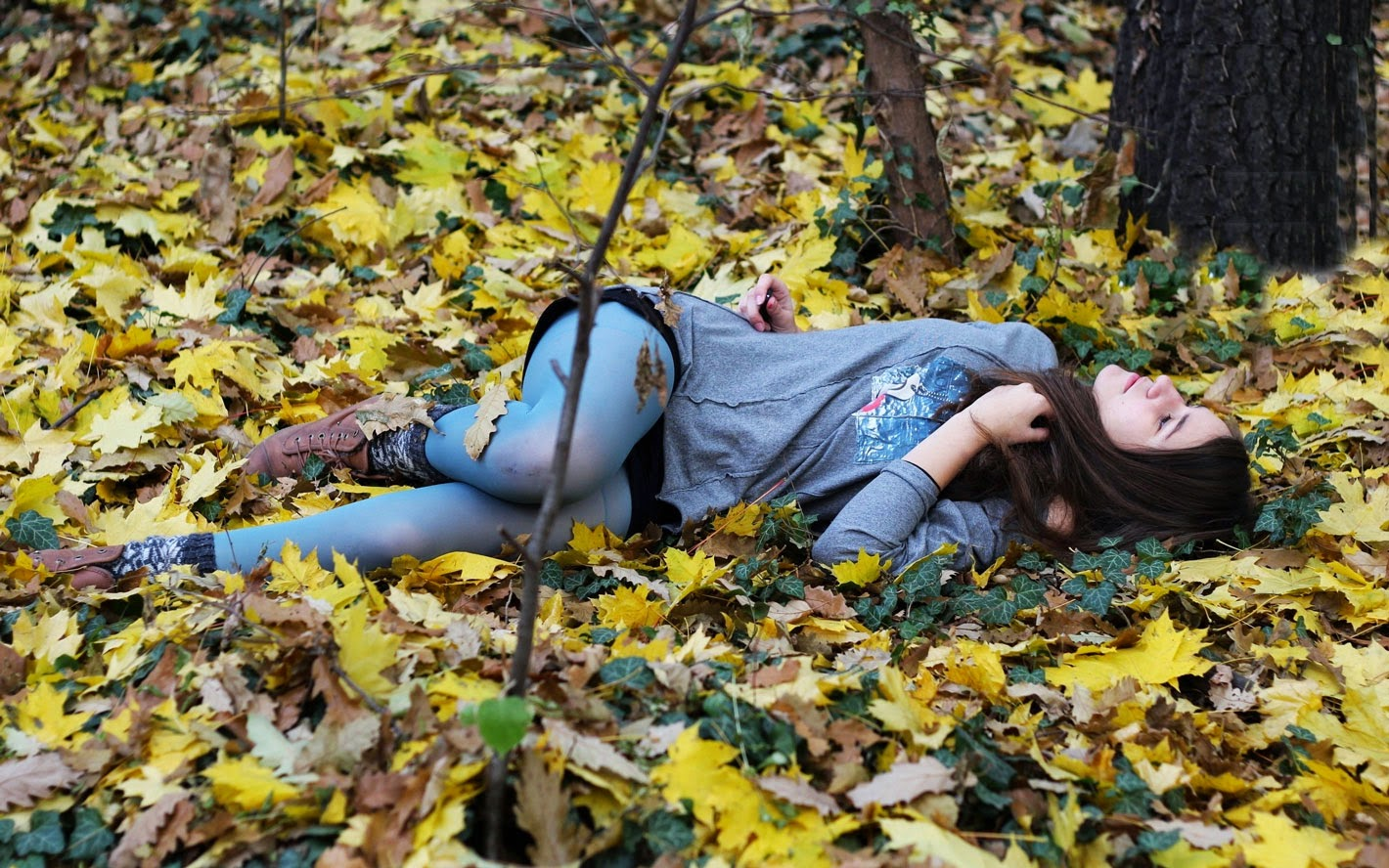 Girl laying on Ground Wallpaper