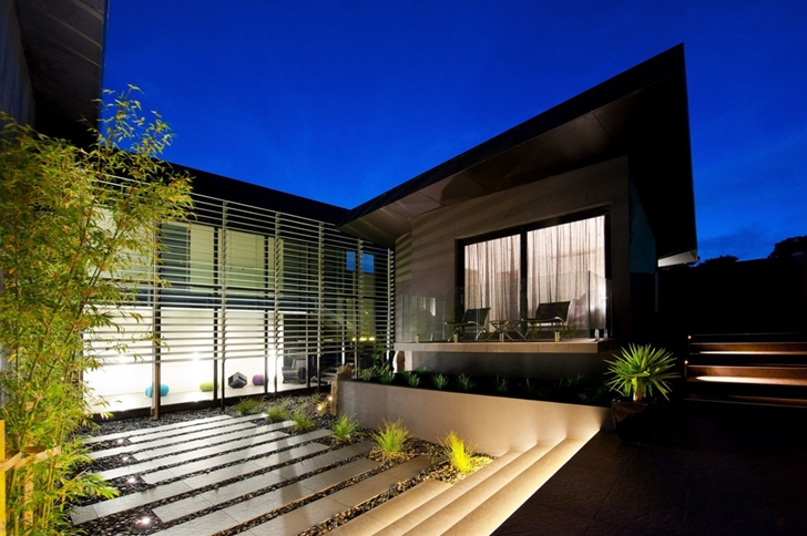 Modern exterior facade at night on Dream home in black and blue