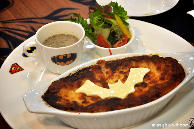 beef lasagna served with salad and mushroom soup