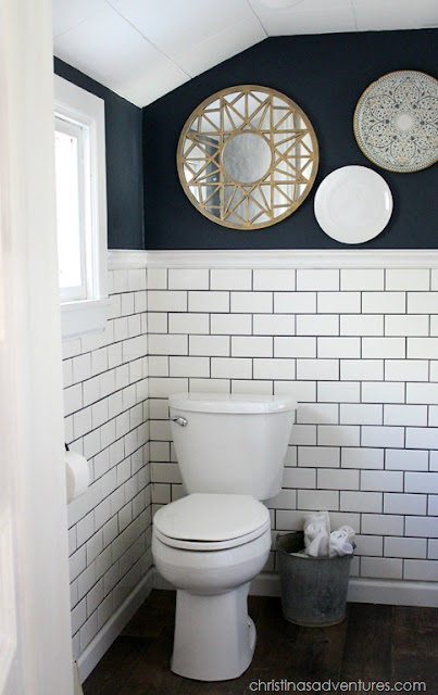 Dark walls subway tile bathroom