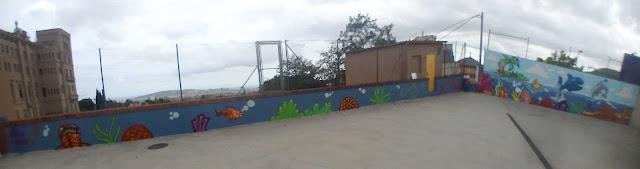 Pintura mural infantil en parking de Escola Pia
