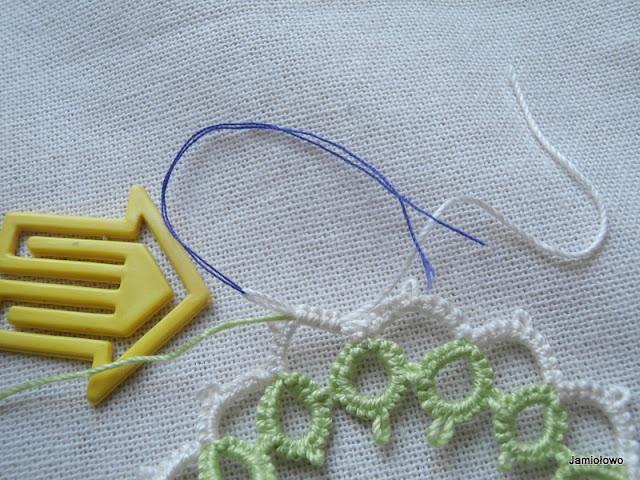 związanie końcówek nici, obcięcie i sklejenie węzła