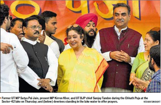 Former UT MP Satya Pal Jain and present MP Kirron Kher during the Chhath Puja at the Sector 42 lake on Thursday